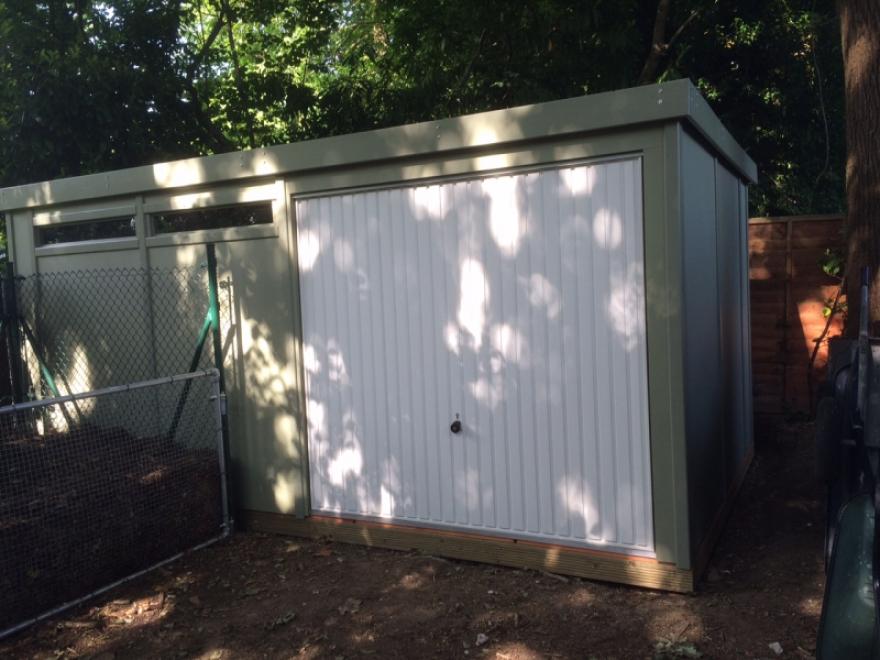 5m x 3m painted Rook workshop with garage doors