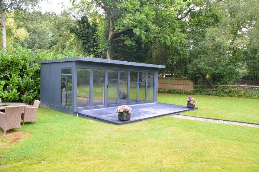 bi-fold door garden-room in anthracite with composite decking Surrey