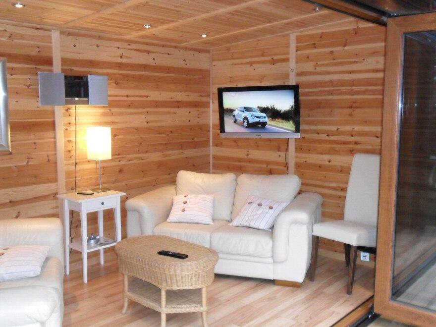 Wooden Garden Rooms with flatscreen tv installation