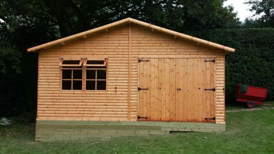 18' x 10' Raven featuring garage doors and Kestrel opening windows