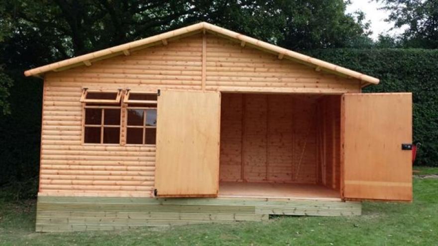18' wide by 10' deep - this Raven features garage opening doors