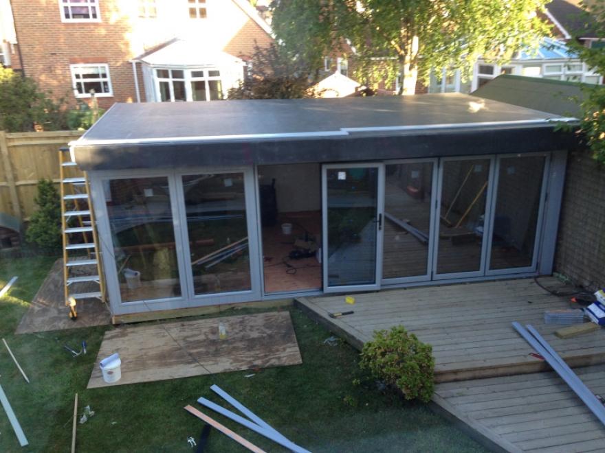 Midway through installation, Firestone stone roof installed
