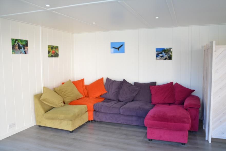 The inviting bright and colourful corner sofa.