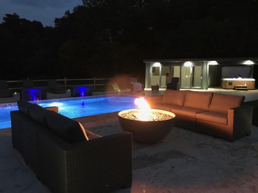 stunning poolside room features external downlighters