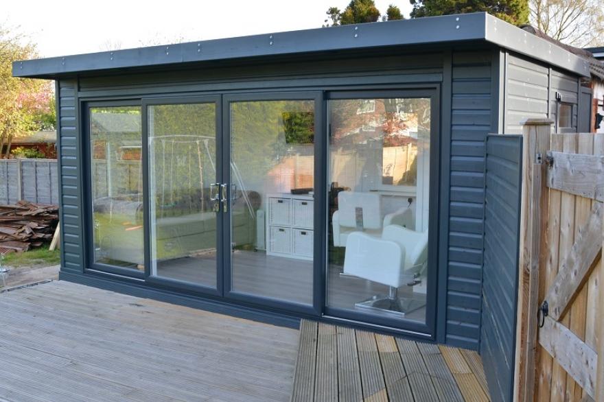 replacement garage with garden room