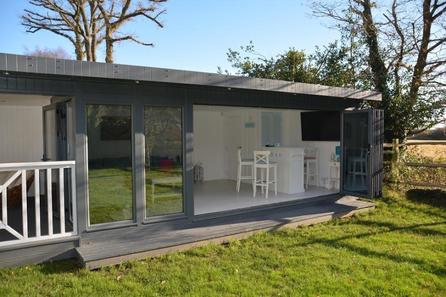 This garden room with bi-folding doors really allows the garden 'in'