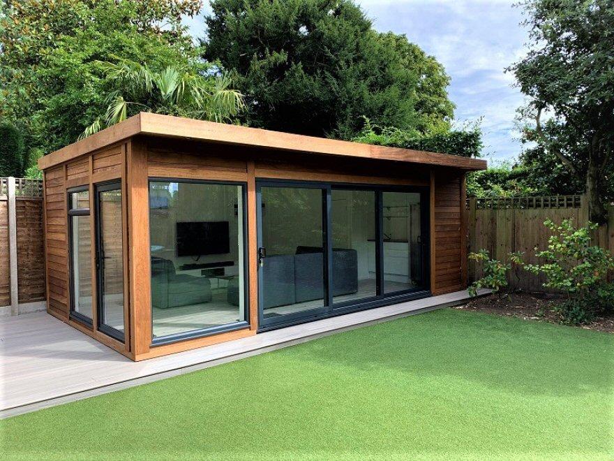 contemporary garden room with aluminium windows & tri-sliding doors.  Clad in Iroko