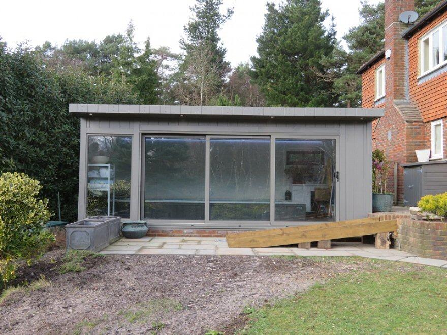 contemporary endless pool room with aluminium tri-sliding doors