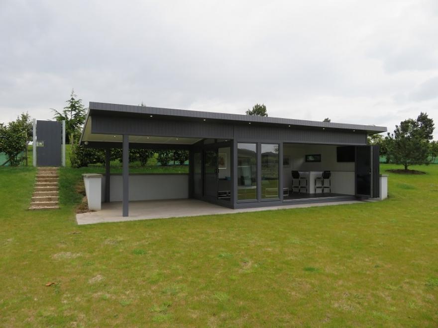 Bi-fold and sliding door garden room with canopy installed in Essex