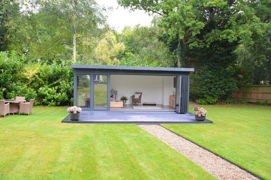 Bi-fold door garden lounge with decking to front  in Domewood surrey