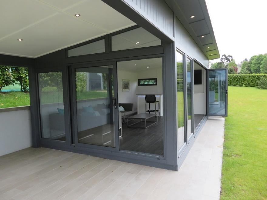 Bi-fold and sliding door garden room in 7015 slate grey with canopy installed in Essex