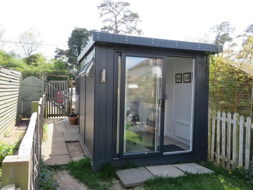 Compact Garden Office with Sliding UPVC Door installed in Betchworth Surrey