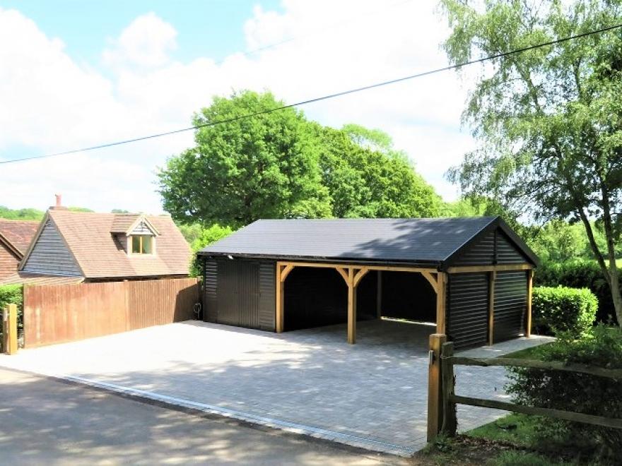Lovely Large Workshop / Carport / Garage in Black Installed in West Sussex