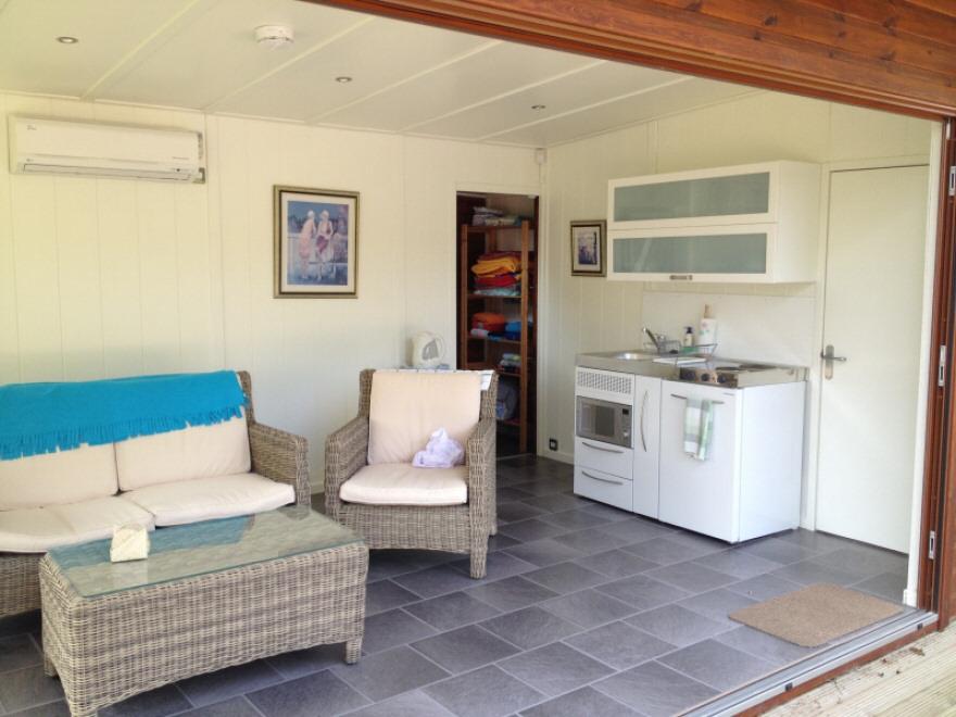 Main room with kitchenette and doorway to corridor