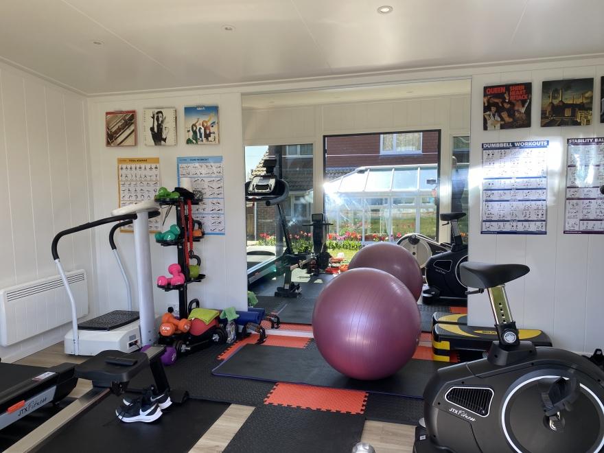 garden gym with mirrors and machines Brighton