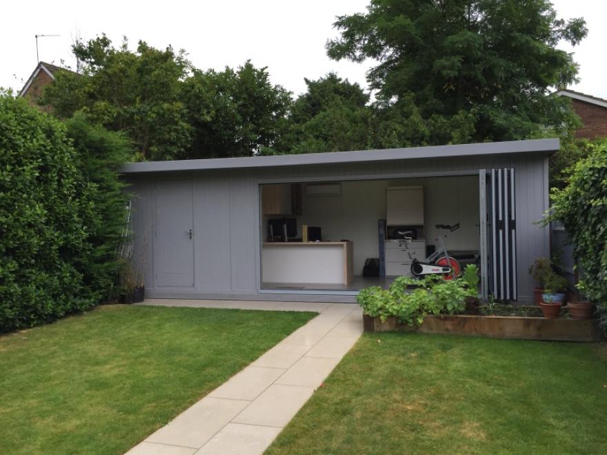 Sleek & impressive 7,5m x 3,1m bi-fold garden office with integrated storage area