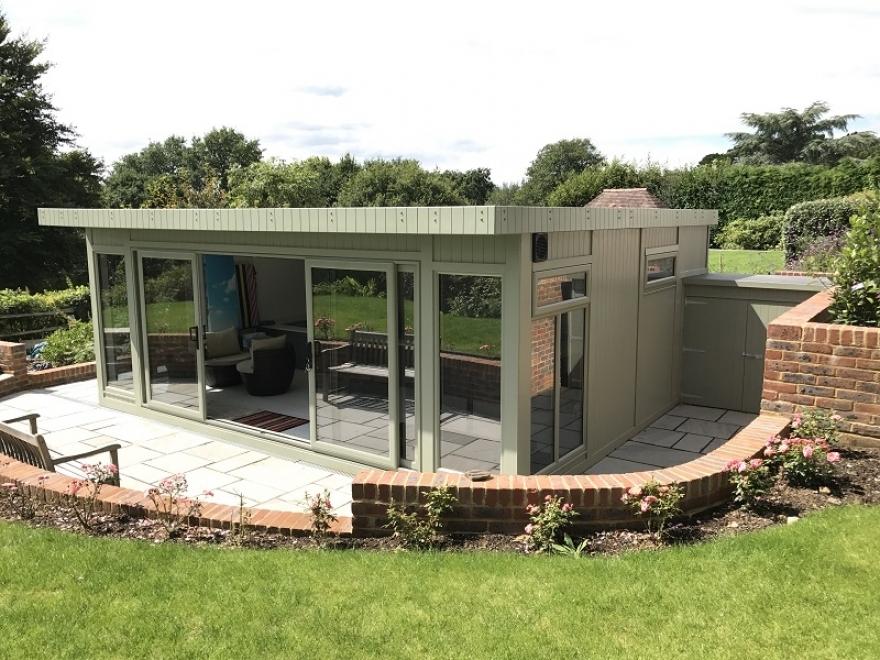 6x5m UPVC sliding door summerhouse is finished in Jungle green