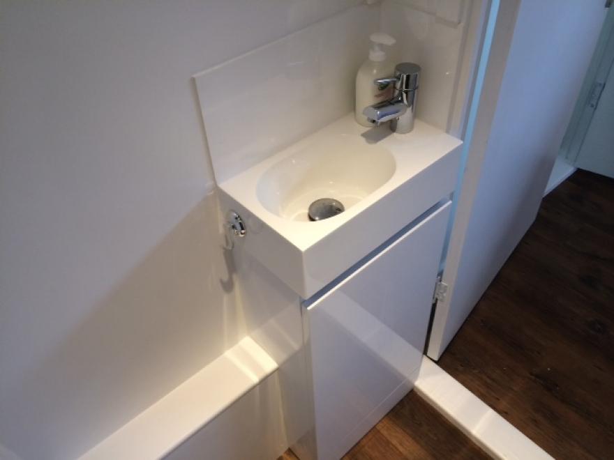 This sleek wash basin fits snugly into the bathroom